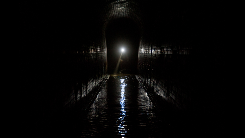 A Thames Water employee conducts and inspection of the Fleet River sewer tunnel