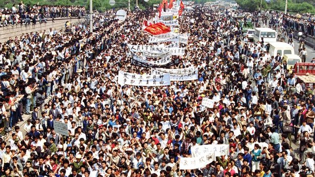 Students from local colleges and universities march to Tiananmen Square, Beijing, to demonstrate for government reform