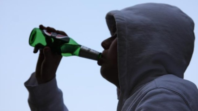 Young person drinking beer