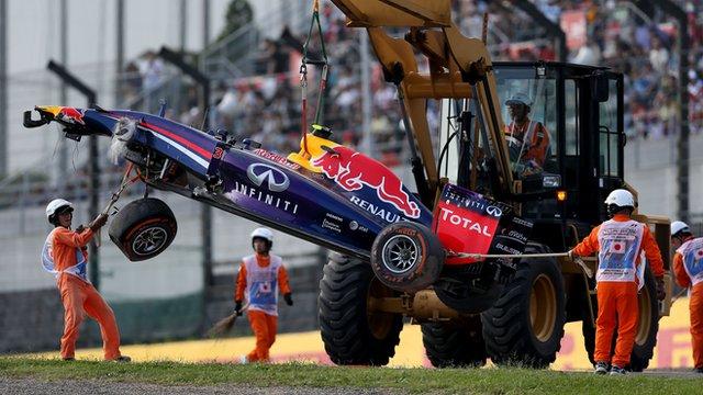 Daniel Ricciardo's Red Bull is craned away