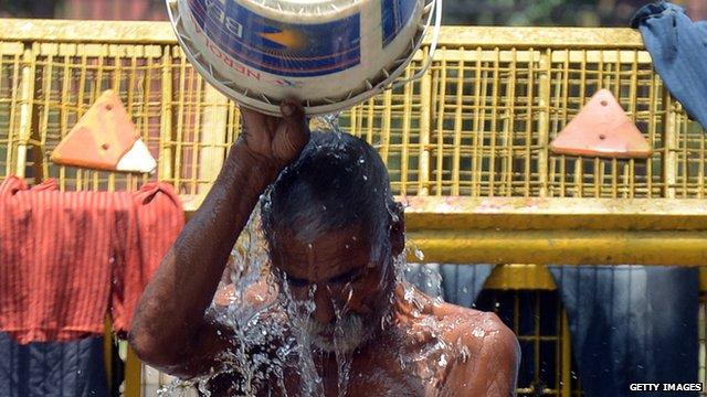 Indian man takes a bath