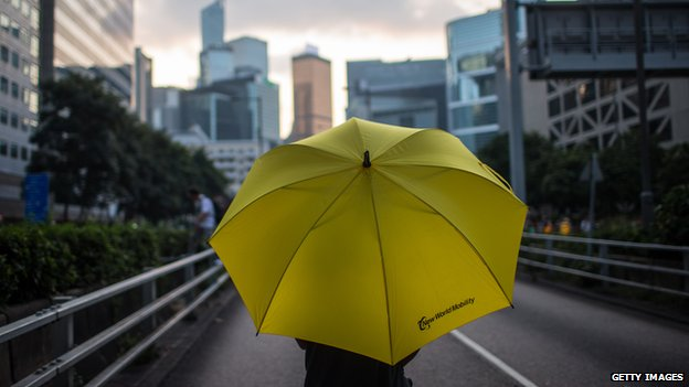A protester carries an umbrella in Hong Kong