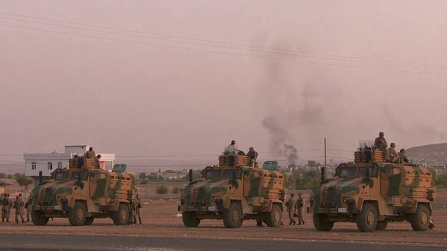 Turkish tanks face away from border town Kobane