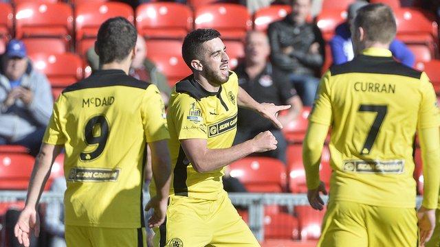 Cliftonville's Joe Gormley celebrates scoring the winning goal against Crusaders at Seaview