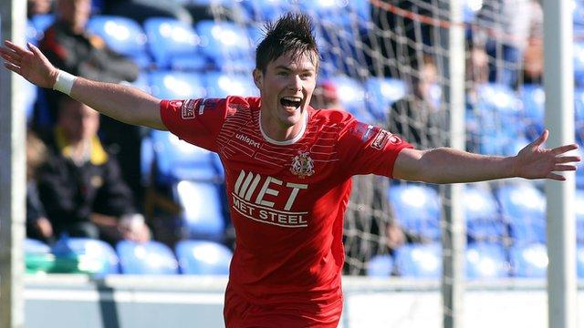 Portadown's Peter McMahon celebrates his second goal against Institute
