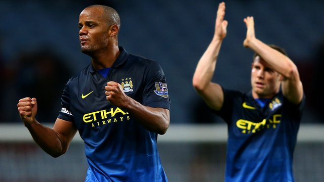 Manchester City players Vincent Kompany and James Milner celebrate after their 2-0 victory over Aston Villa