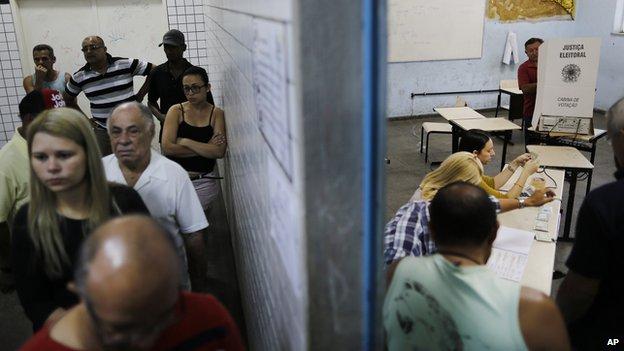 general elections inside a school in the Nova Holanda slum located in the Complexo da Mare in Rio de Janeiro, Brazil, Sunday, Oct. 5, 2014