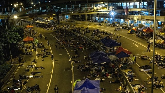 Pro-democracy protestors sleep on streets outside Hong Kong Government complex