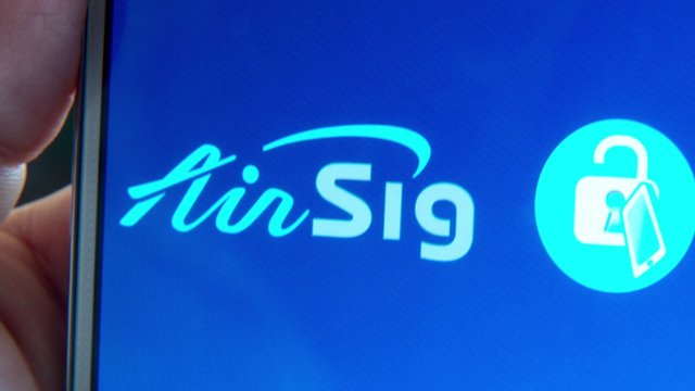 Close up of smartphone screen showing AirSig logo