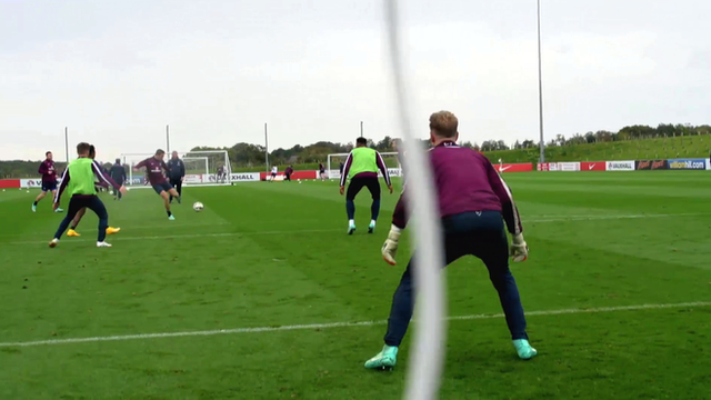 England and Liverpool midfielder, Jordan Henderson scores volley against England and Manchester City goalkeeper, Joe Hart in training