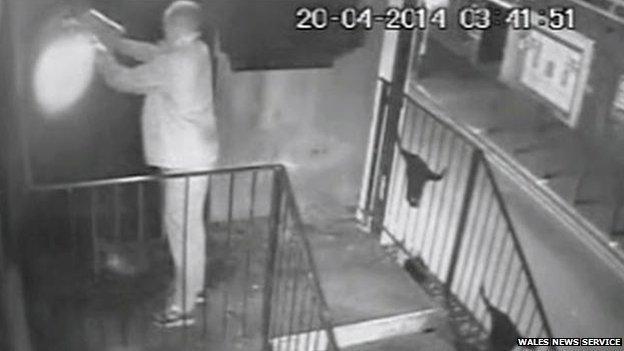 Craig Cullen pours petrol on the nightclub door