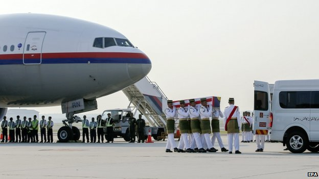 The remains of three Malaysian victims arrive in Kuala Lumpur (19 Sept)