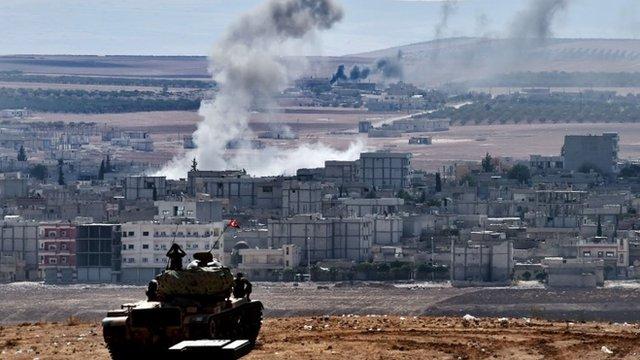 Tank overlooking Kobane