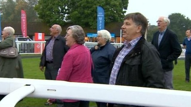 Racehorse owners celebrate a winner at Worcester