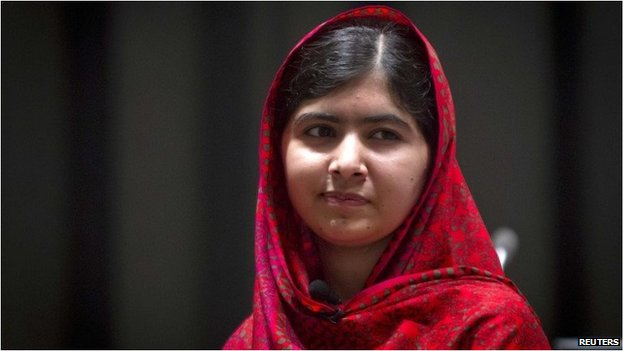 Pakistani schoolgirl activist Malala Yousafzai poses for pictures during a photo opportunity in