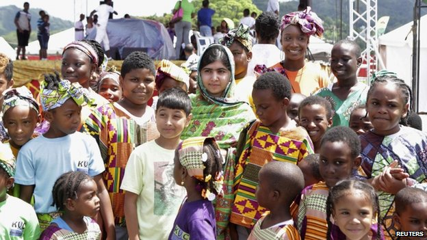 "Pakistani schoolgirl activist Malala Yousafzai poses for a photo with children attending a workshop, during her visit to the Emancipation Village at Queen""s Park Savannah, in Port of Spain"