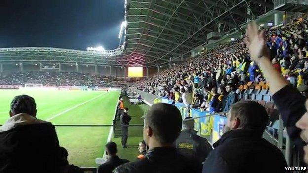 Fans chant at the Ukraine-Belarus Euro 2016 match in Borisov, Belarus, on 9 October 2014
