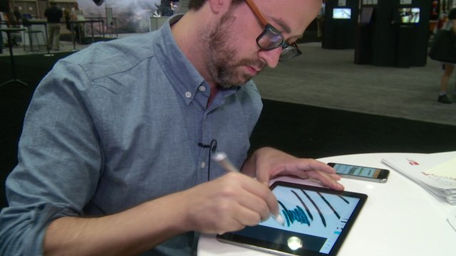 A man drawing using a tablet