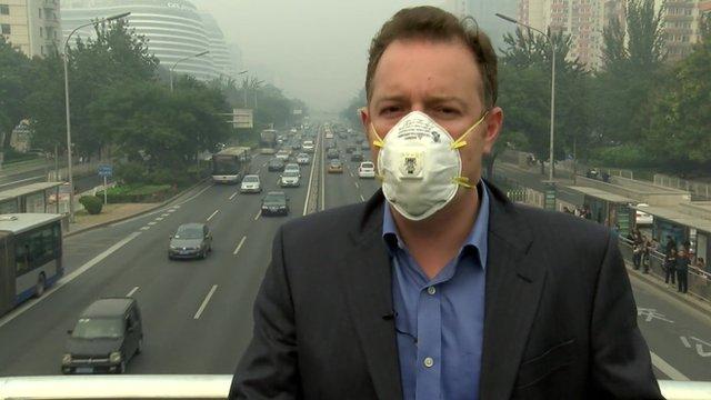 Martin Patience wearing a gas mask in Beijing