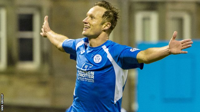 Iain Russell celebrates his late winner for Queen of the South
