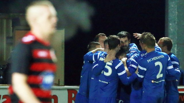 Ballinamallard players celebrate victory over Coleraine at Ferney Park.