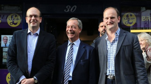 """Ukip leader Nigel Farage (centre) and newly elected Ukip MP Douglas Carswell (right) joins their party""""s candidate Mark Reckless on Rochester High Street"""
