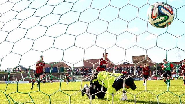 Crusaders Diarmuid O'Carroll fires a penalty past Glentoran goalkeeper Elliott Morris