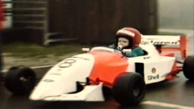 A two-year-old Kevin Magnussen drives a replica F1 car