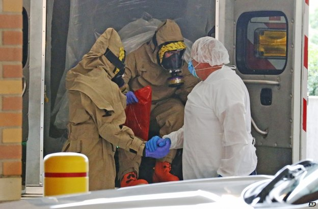 Staff in protective suits at Texas Health Presbyterian Hospital, Dallas, 8 October
