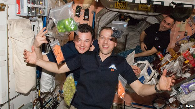 Space workers take delivery of fresh food supplies on board the International Space Station