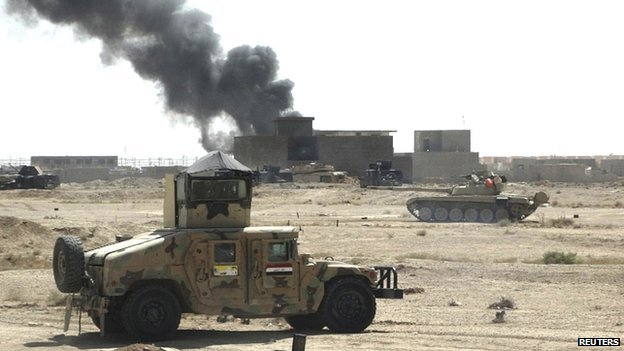 Iraqi troops clash with Islamic State militants, on the outskirts of Ramadi. 20 Sept 2014