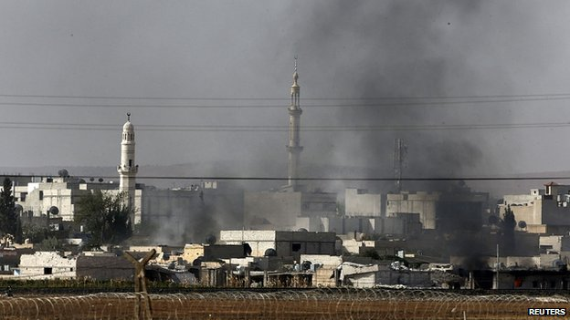 Smoke rises above Kobane. 13 Oct 2014