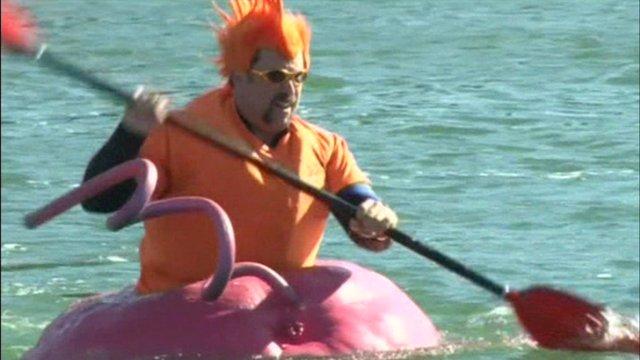 A man swimming in a giant pumpkin
