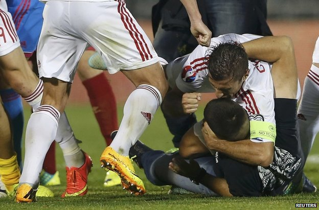 Albania players brawl with Serbia fans at the stadium in Belgrade, 14 October