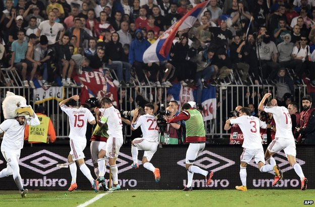 Albania players leave the field at the stadium in Belgrade, 14 October