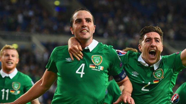 John O'Shea celebrates scoring against Germany