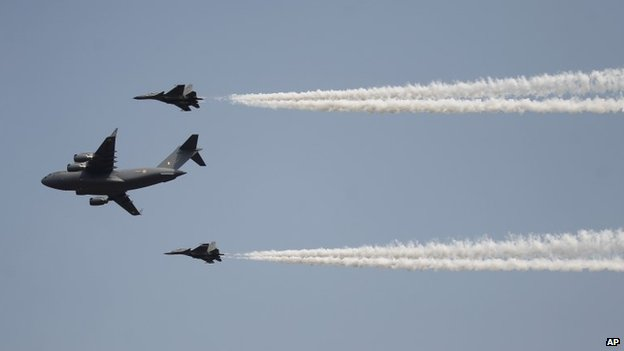 "Indian Air Force""s C-17 Globemaster III, center, with Sukhoi Su-30MKI flies in formation whiles displaying aerial demonstration during Air Force Day at the air force station in Hindon near New Delhi, India, Wednesday, Oct. 8, 2014."