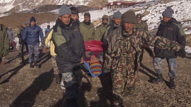 Nepalese army personnel carry a victim rescued from the avalanche at Thorang-La in Annapurna Region in this October 15, 2014 handout photo provided by Nepal Army