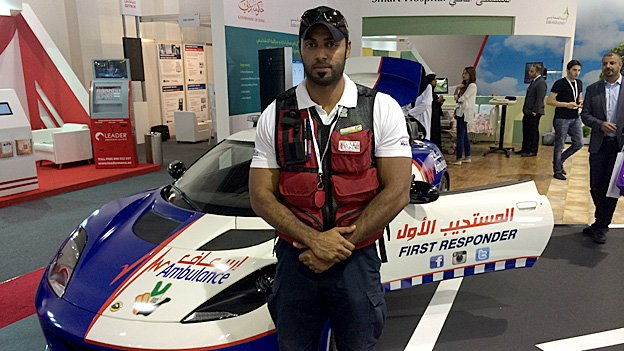 Dubai paramedic Zaid Al Mamari in front of the new ambulance