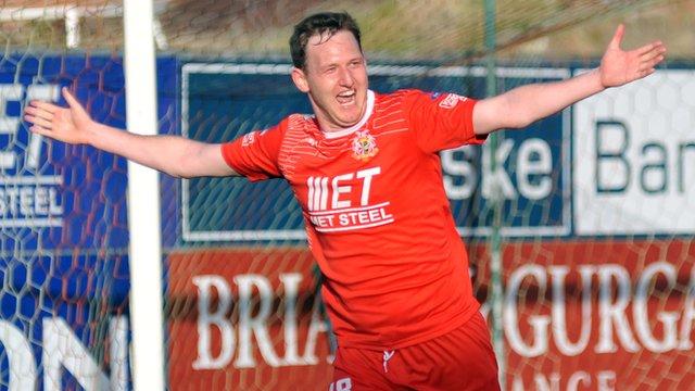 Portadown's Gary Twigg celebrates his goal against Ballymena United