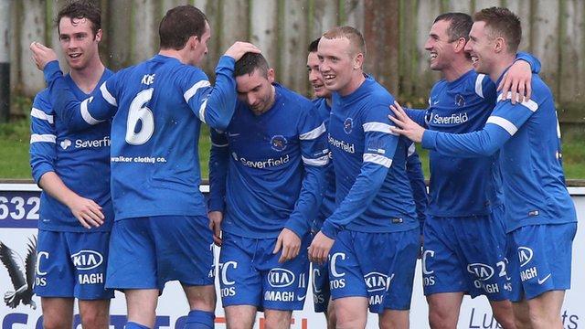 Ballinamallard players celebrate victory over Dungannon Swifts
