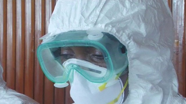 Woman with protective clothing on