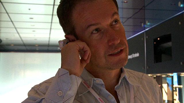 Dan Simmons using a finger ring phone