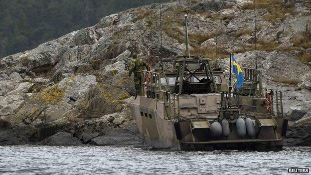 An assault vehicle lands an search team on an island in Stockholm's archipelago