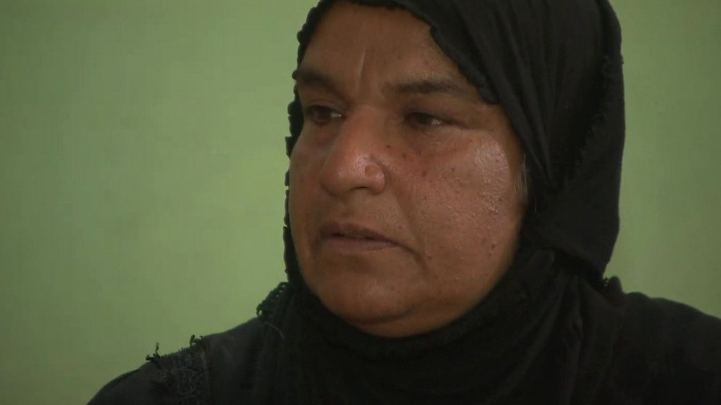 Umm Ahmed, an Iraqi woman whose son, husband and brothers-in-law vanished overnight