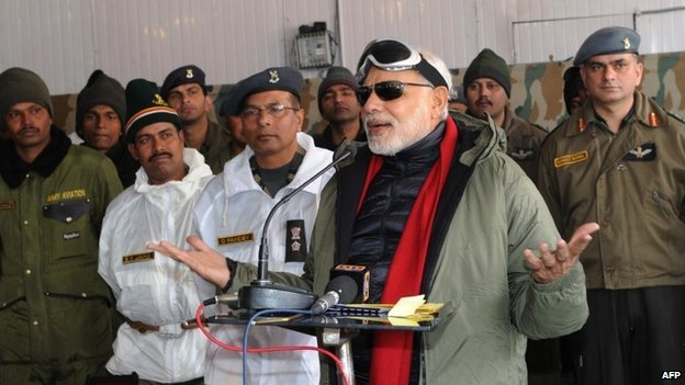 In this handout photograph released by the Press Information Bureau (PIB) on October 23, 2014, Indian Prime Minister Narendra Modi addresses Indian Army personnel at Siachen Base Camp during an unannounced visit to Siachen on October 23, 2014.