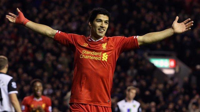 Luis Suarez celebrates scoring for Liverpool against Norwich