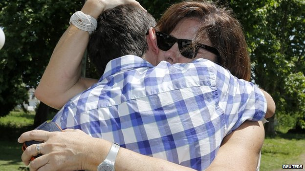 Patricia Perez Catan is embraced by her brother Fernando as they visit the former notorious clandestine detention centre known as La Cacha during Argentina's last dictatorship, in La Plata on 24 October 2014