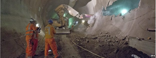 Workers in an underground Crossrail tunnel