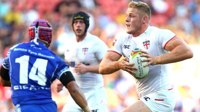 England's Tom Burgess runs against Samoa